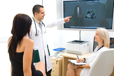 sonogram: A doctor shows the patient on the monitor of the ultrasound image  Stock Photo