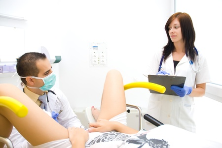 gynecologist: A gynecological examination Shooting a real doctor
