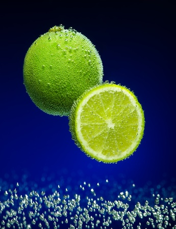 Beautiful lime close-up photo with carbon dioxide bubbles photo