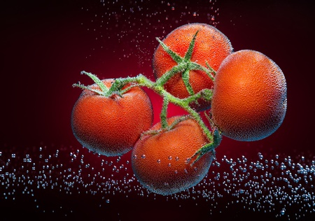 Beautiful tomatoes close-up photo with carbon dioxide bubbles photo