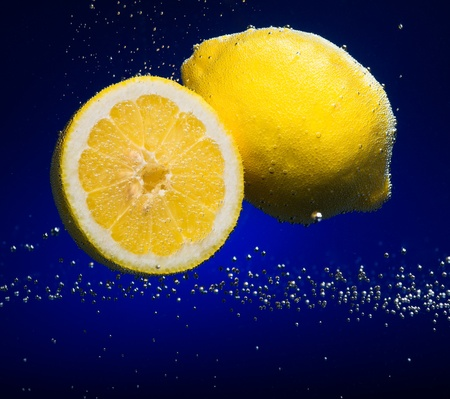 Beautiful lemon close-up photo with carbon dioxide bubbles photo