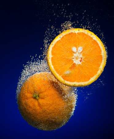 Beautiful orange close-up photo with carbon dioxide bubbles photo