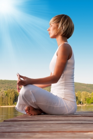 Young woman meditating on the sunshine Stock Photo - 19910107