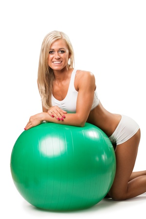 Young woman with fitness ball, isolated over white background Stock Photo - 20109770