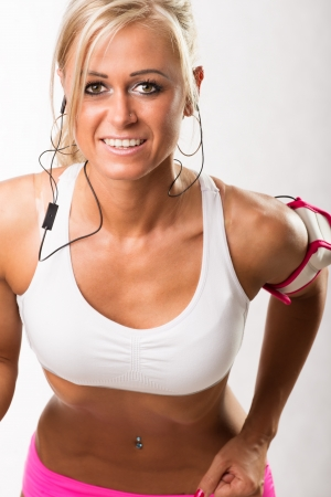 Fit young woman training physically at the gym  Isolated white background Stock Photo - 20109771