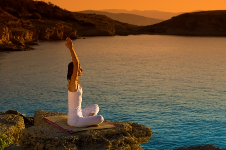 yoga girl: Attractive young woman in a yoga position on a beautiful beach