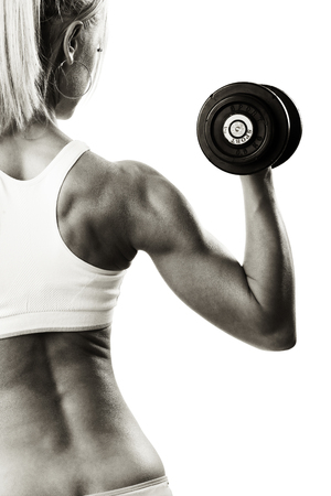 Back view portrait muscular blond woman holding dumbbell photo