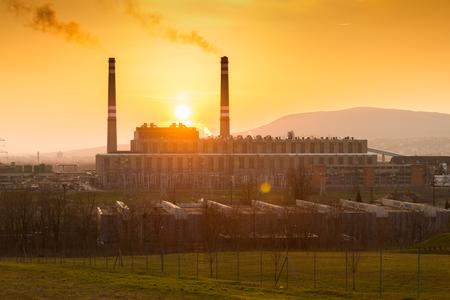 factory smoke at sunset photo