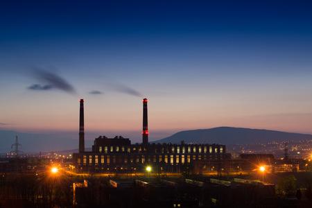 Factory smoke at night photo