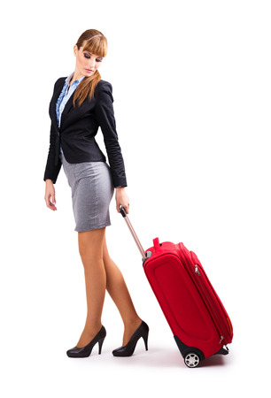 Woman on a business trip  Isolated on white photo
