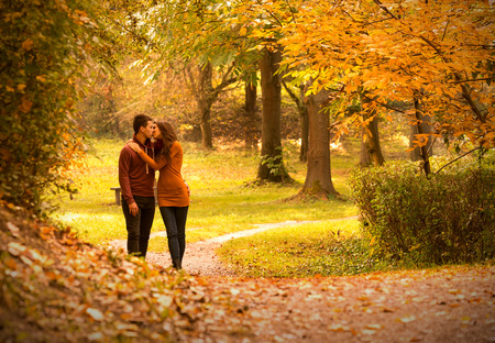 Kiss in autumn park photo
