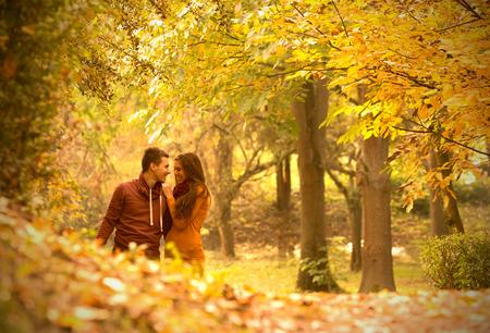 falls: passionate love in the autumn park Stock Photo