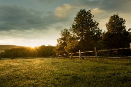 rolling landscapes: Beautiful sunrise on the farm Stock Photo