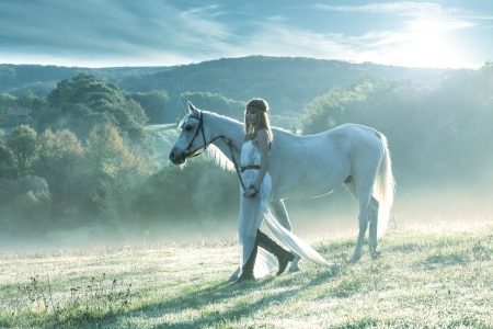 Beautiful sensual women with white horse photo