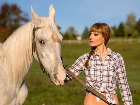 Portrait of a white horse and woman photo