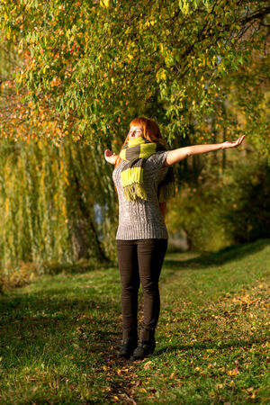 Beautiful-haired woman enjoying  freedom, autumn sunshine photo