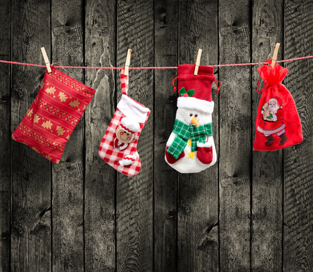 santa s bag: Santa s bag on the clothesline, with wood background Stock Photo