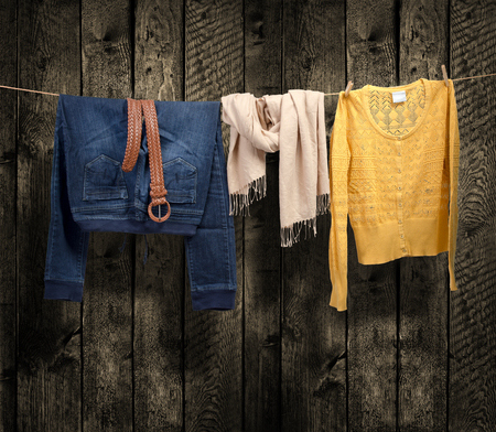 clothesline: Women s clothing on a clothesline on wood background