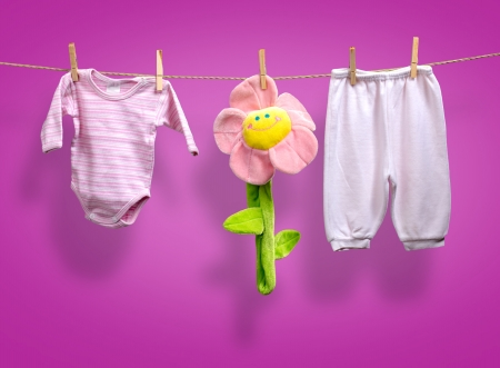Baby girl y clothes   on the clothesline photo