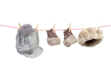 earmuffs: Women s winter accessories on the clothesline Stock Photo