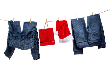 santa s bag: Jeans, with gift bag and santa hats on the clothesline
