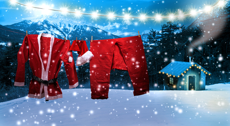christmas morning: Santa clothing hanging on a clothes line Stock Photo