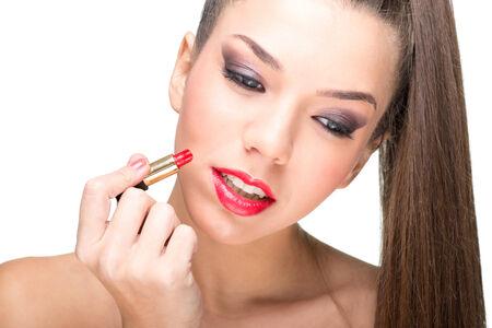 fair skinned: Beautiful fair skinned woman using a red lipstick