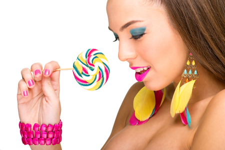 Colorful fashion model with lollipop photo