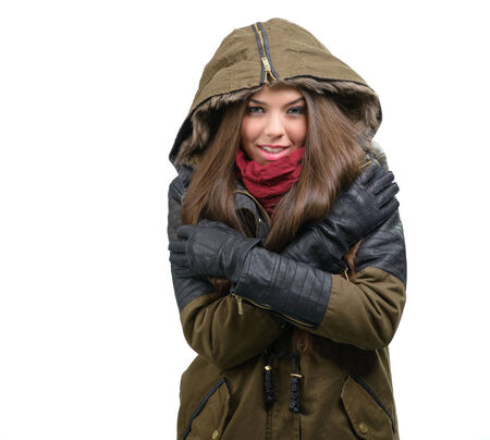 Happy young woman in winter clothes photo