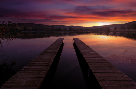 still water: Mystical Landscape, two long pier at dawn