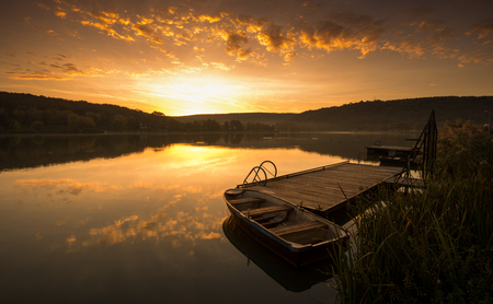 Mystical Landscape, Boat on the Pier at sunrise photo
