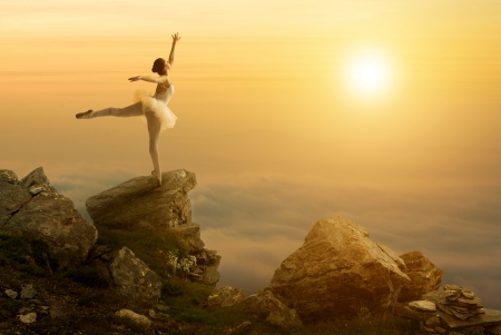 Mystic pictures, ballet dancer stands on the cliff edge photo