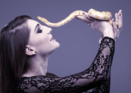 animal sexy: Woman holds in her hand the snake Stock Photo
