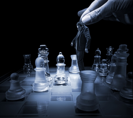 Businessman on a chessboard as a dummy photo