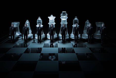 chess board: Glass chess board - Businessman peasants site Stock Photo