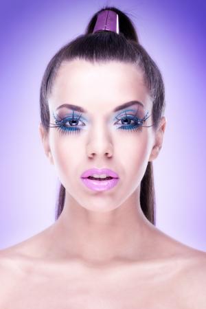 Makeup  Model with extreme makeup photo