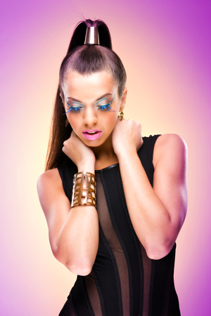 Fashion Model with luxury makeup and clothes photo