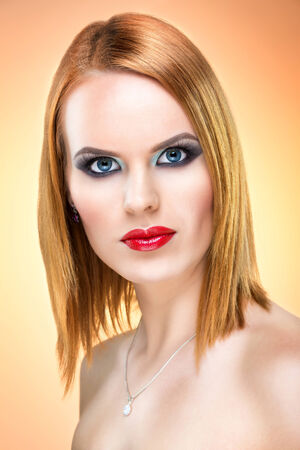 Beautiful blue-eyed woman with extreme makeup photo