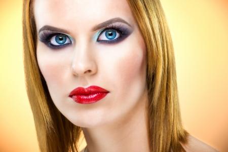 Beautiful blue-eyed woman with luxury make-up photo