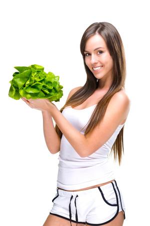 healthful: Saludable mujer en forma de comer y bella mujer con una ensalada