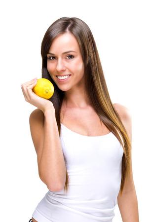 healthful: Eating-una saludable mujer hermosa celebraci�n de las naranjas Foto de archivo