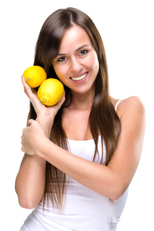 Healthy lifestyle - Beautiful pretty woman is holding two lemons