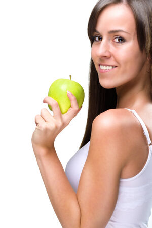Healthful eating-Beautiful natural woman holds an apple  photo