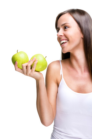 Healthful eating-Lovely woman holding an apple while laughing  photo
