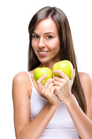 Healthy lifestyle - Beautiful, natural woman holds an two  apple  photo