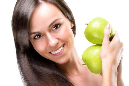 Healthful eating-Beautiful woman holding apples, close-up photo  photo