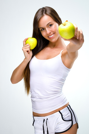 Eat healthily - Beautiful woman shows the apples  Stock Photo