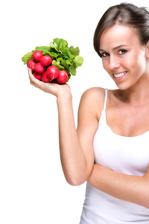 healthily: Long live healthily - Beautiful woman holding a bunch of radishes Stock Photo