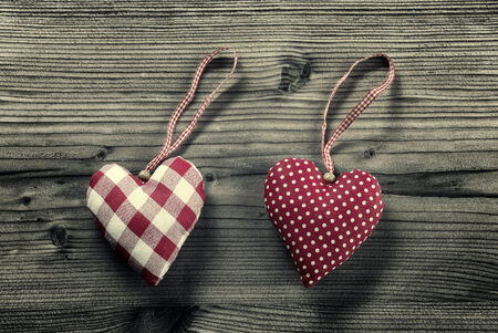 plano: 2 pieces of fabric hearts, polka dots , plaid, on wood background Stock Photo
