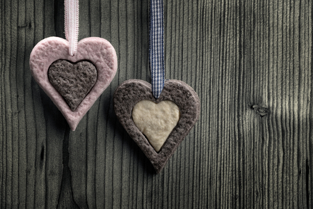 Heart-shaped biscuits with two colors - wood background photo